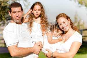 Caucasian happy family in the park