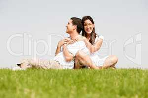 Happy young women with arms around her husband