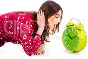 lady looking at alarm clock