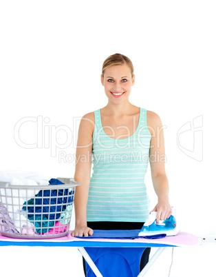 Joyful woman ironing her clothes