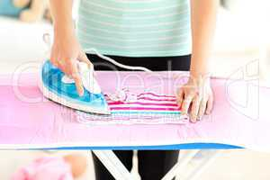 Close-up of a caucasian woman ironing her clothes