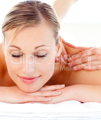 Portrait of an attractive woman lying on a massage table