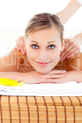 Portrait of a bright woman lying on a massage table