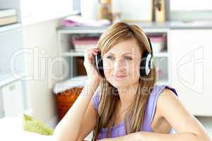 Kind woman listening to music at home