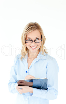 Smiling businesswoman wearing glasses and holding a clipboard