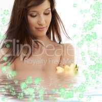 brunette with yellow lily and flowers in water