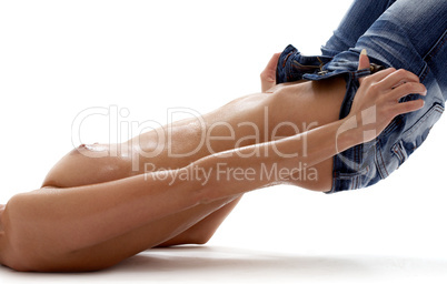 laying topless girl pulling jeans down