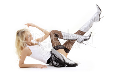 laying blonde in silver boots