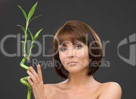 brunette with bamboo over grey
