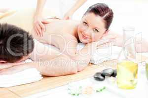 Caucasian young couple receiving a back massage