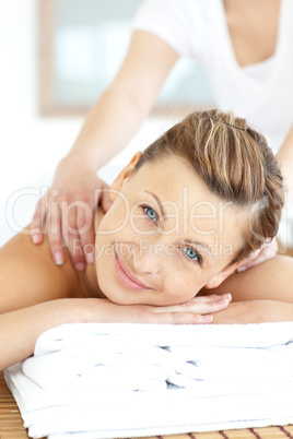 Beautiful young woman enjoying a back massage