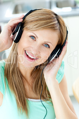 Delighted caucasian woman listening to music with headphones in