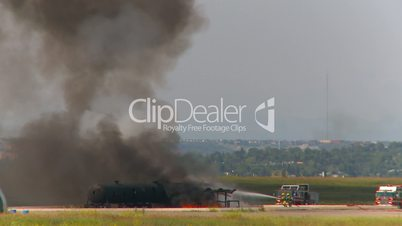 time-lapse airport fire training, hose attacks and steam