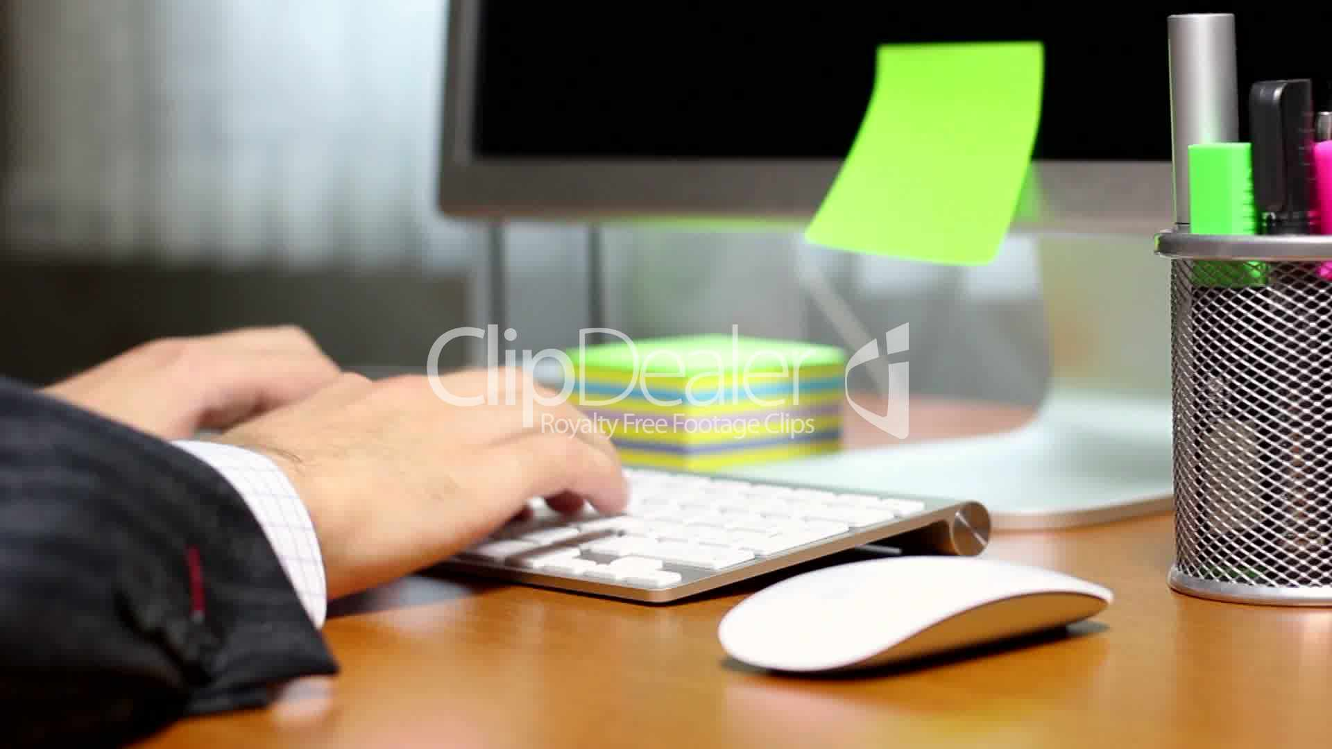 hd businessman typing on  puter keyboard at office
