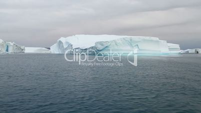 Sailing by an iceberg