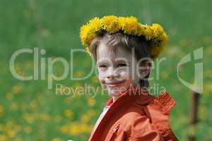 Boy in dandelion meadow.