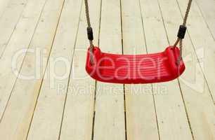 Rote KinderschaukelRed children's swing