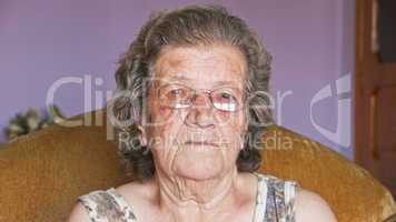 Portrait of senior woman smiling in home