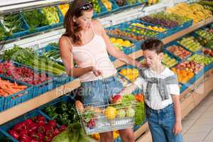 Grocery store shopping - Mother with child buying fruit