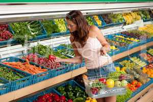 Grocery store shopping - Young woman buying vegetable