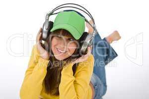 Happy female teenager enjoy music with headphones