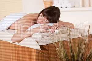 Spa - Young female client at wellness massage