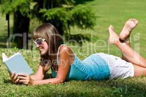 Relax in park - woman with book on sunny day
