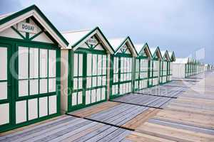 Wide angle view of wooden beach huts