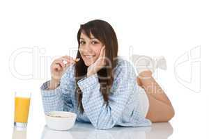 Smiling woman eat cereal for breakfast