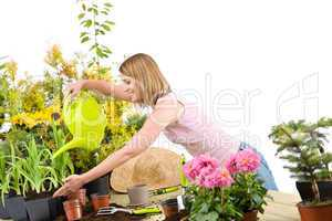 Gardening - woman pouring water to plant