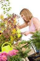 Gardening - woman sprinkling water to plant