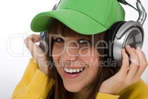 Happy female teenager enjoy music