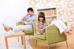 Student - two teenager reading book in lounge