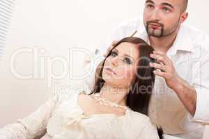 Professional hairdresser comb female customer at salon