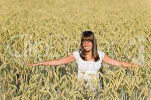Happy young woman in corn field