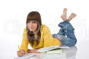 Student - Happy female teenager write homework
