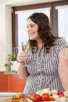 Cook - plus size woman with white wine and vegetable