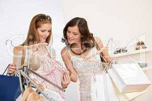 Fashion shopping -  Two happy young woman choose clothes