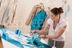 Professional tailor working with fashion sketches