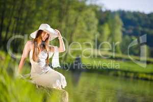 Long red hair romantic woman relax by lake
