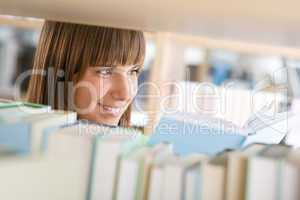 Student in library - happy woman study from book