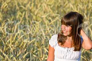Young woman in corn field enjoy sunset