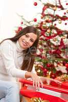 Happy woman wrapping Christmas present