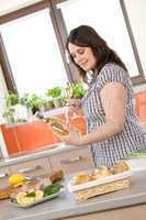 Cook - plus size woman prepare fish with white wine