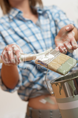 Home improvement: Woman holding paint brush