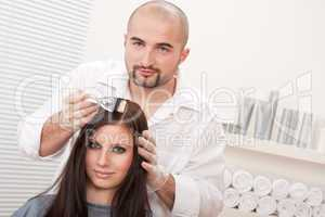 Professional hairdresser color customer at salon