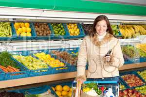 Grocery store shopping - Smiling woman with mobile phone