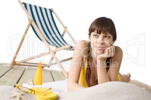 Beach with deck chair - Woman in bikini sunbathing