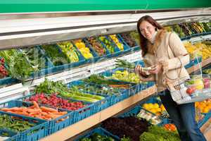Grocery store shopping - Woman holding spring onion