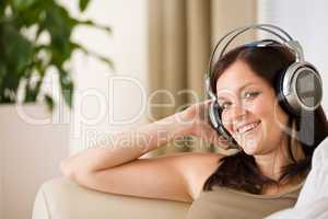 Woman with headphones listen to music  in lounge